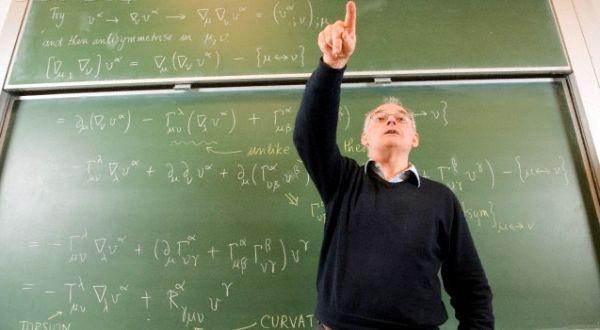 Professor teaching in front of blackboard